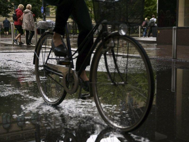 A cyclist drove through a puddle of water in central Helsinki on Sunday.