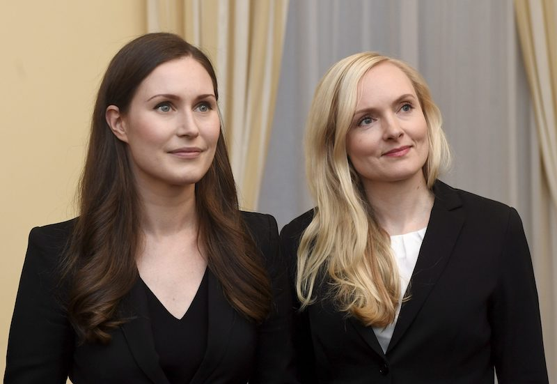 The new Prime Minister of Finland Sanna Marin with the Minister of Interior Maria Ohisalo (R).
