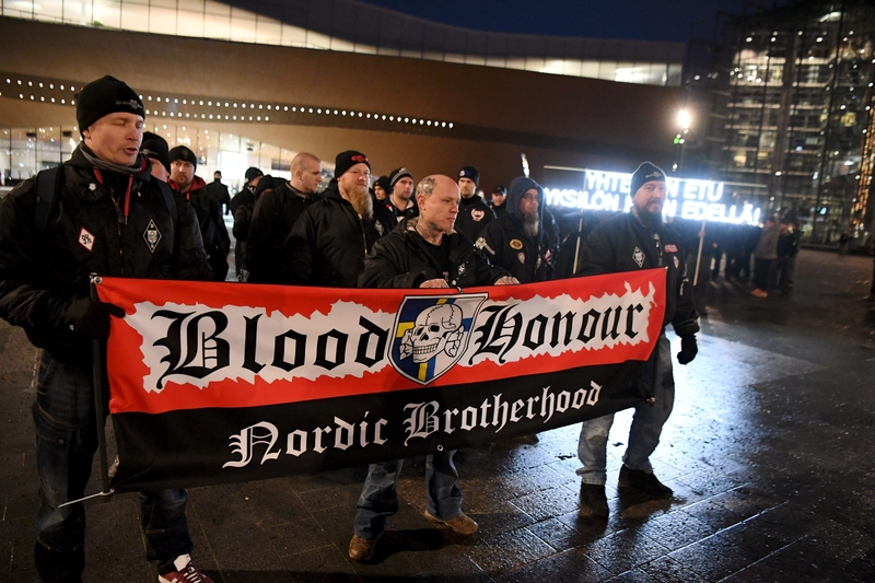 Members of the far-right 'Blood Honour Nordic Brotherhood' attend a Soldiers of Odin parade in central Helsinki on Friday (Image: Lehtikuva)