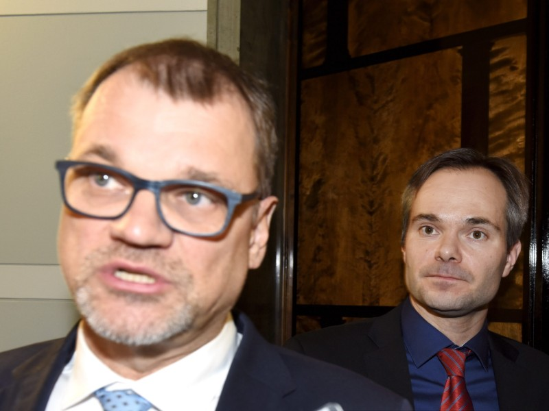 Prime Minister Juha Sipilä (Centre) and Minister of the Interior Kai Mykkänen (NCP) were photographed after a government meeting on sex crimes in the Parliament House in Helsinki on 15 January. (Credit: Heikki Saukkomaa – Lehtikuva)