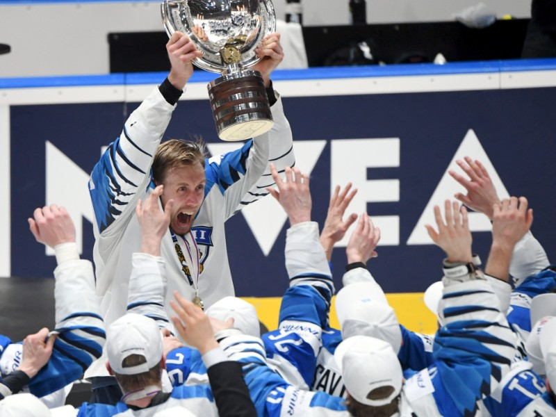 Captain Marko Anttila was surrounded by his team-mates as he hoisted the championship trophy after a 3–1 victory over Canada in the final of the 2019 IIHF Ice Hockey World Championship in Slovakia on Sunday, 26 May. (Jussi Nukari – Lehtikuva)
