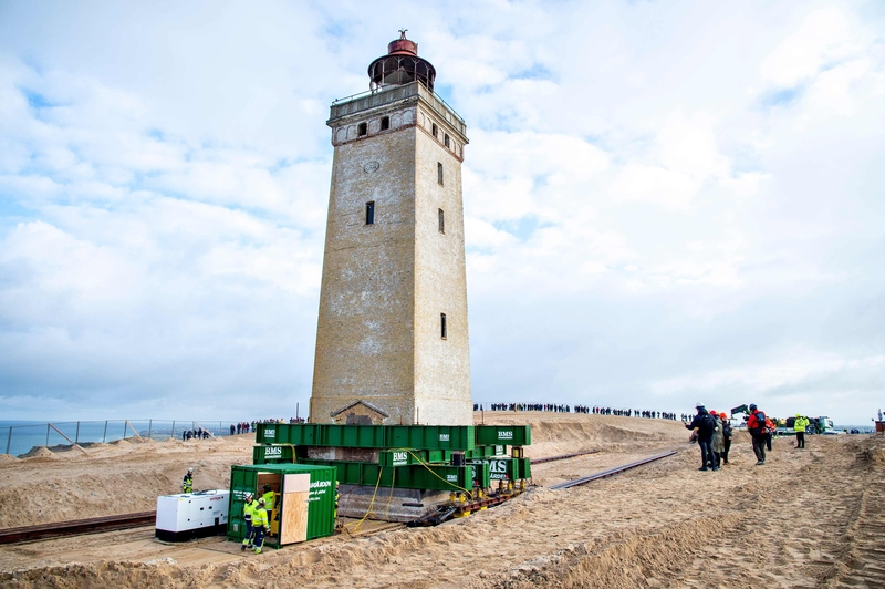 A 120-year-old lighthouse in Denmark is moved inland to escape rising seawaters (Image: Lehtikuva)