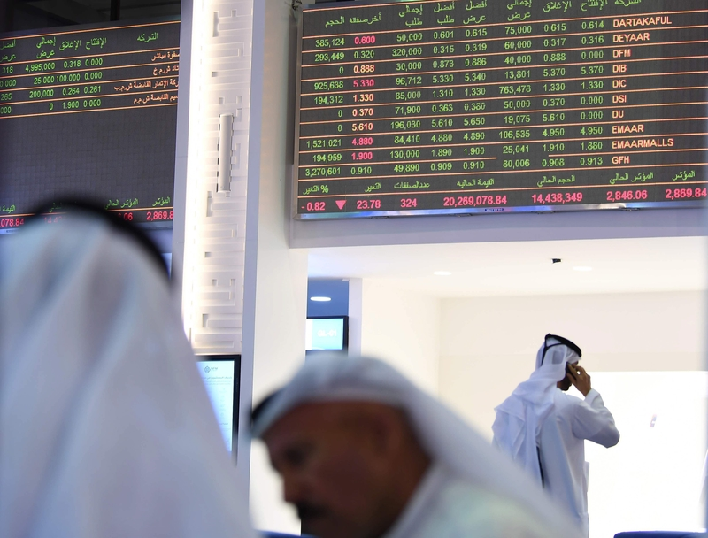 Traders in Dubai watch global share prices nosedive in the wake of the attack this morning (Image: Lehtikuva)