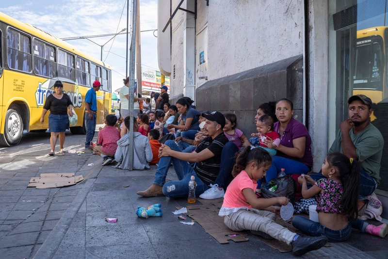 Central American migrants and asylum seekers await a bus near the US border on Friday (Image: Lehtikuva)