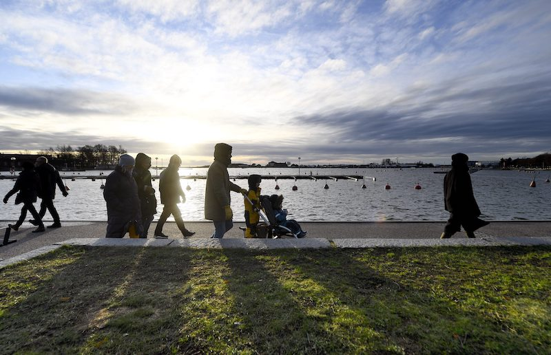Families take a stroll along the shorelines in Helsinki on Wednesday.