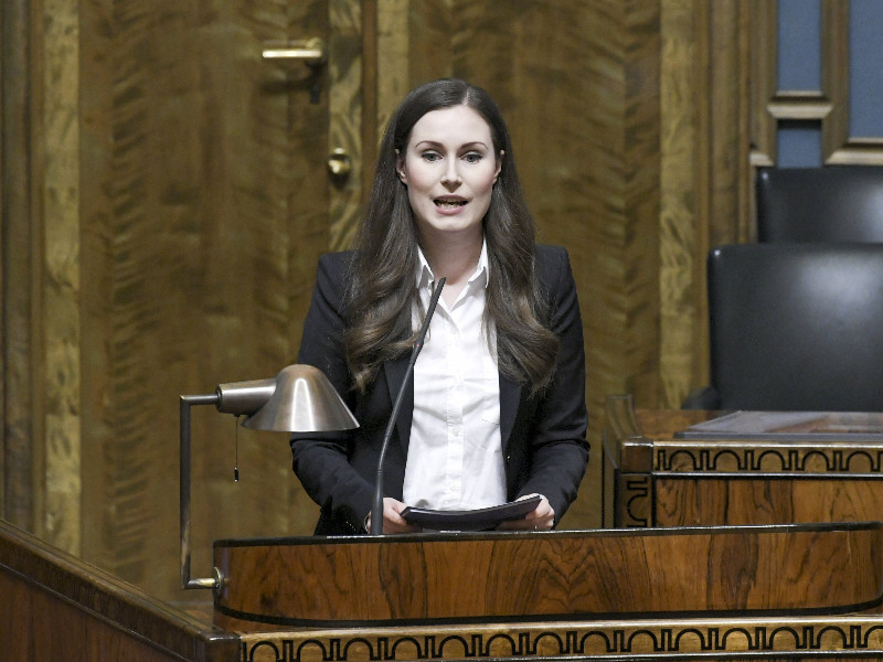 Prime Minister Sanna Marin (SDP) on the rostrum in the session hall of the Finnish Parliament on Tuesday, 11 February 2020. (Markku Ulander – Lehtikuva)