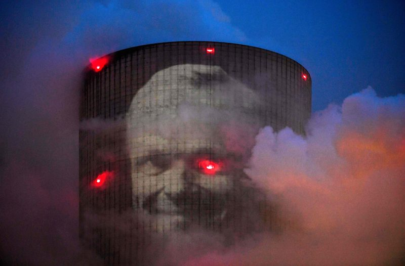 Lundmark's face projected onto a the tower of the coal-fired Datteln power plant (Image: Lehtikuva)
