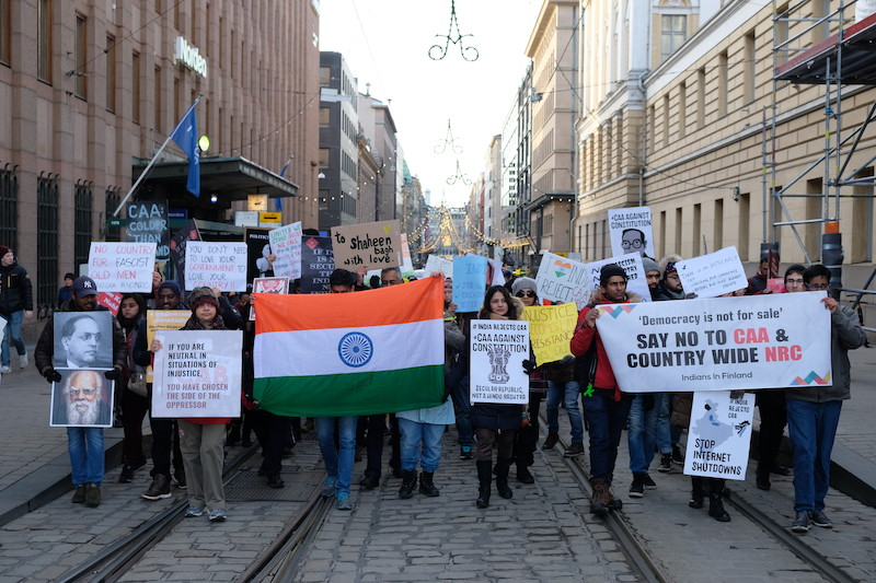Protestors marching down Helsinki's Aleksanterinkatu yesterday (Image: 'Indians Against CAA, Finland)
