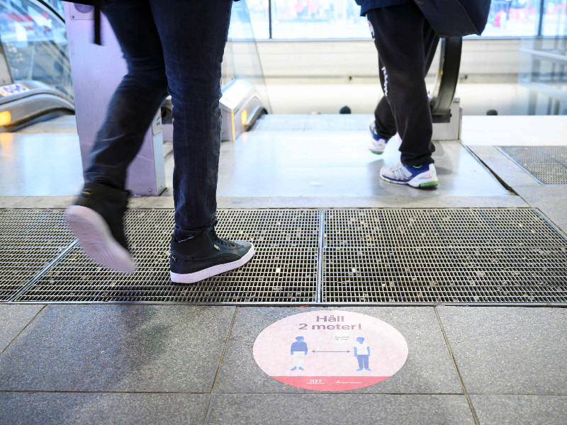 A sticker reminding people to practise social distancing in downtown Stockholm on 12 May 2020. (Henrik Montgomery – AFP/Lehtikuva)
