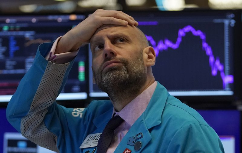 A Wall Street trader looks on in concern as financial markets nosedived this morning (Image: Lehtikuva)