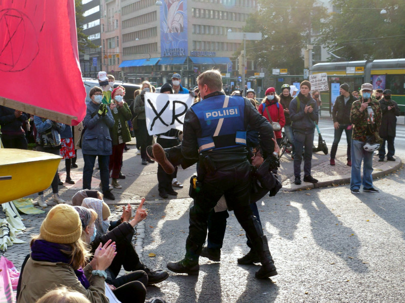 Police officers brought dozens of people into custody during a demonstration organised in downtown Helsinki on 3 October by Extinction Rebellion Finland. (Handout / Jussi Lahti – Extinction Rebellion Finland)