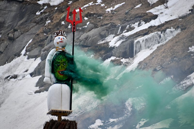 The Boeoegg, a symbolic snowman, is seen burning over the Devil's Bridge during the Sechselaeuten (Ringing of the six o'clock bells) festival near Andermatt, central Switzerland on April 19, 2021. LEHTIKUVA / AFP
