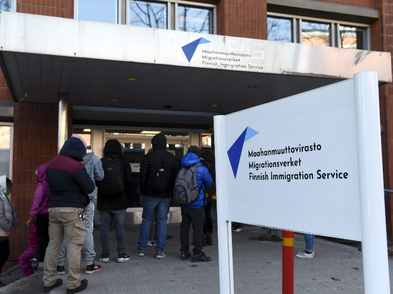 People lined up outside an office of the Finnish Immigration Service (Migri) in Malmi, Helsinki, on 19 April 2021. (Emmi Korhonen – Lehtikuva)