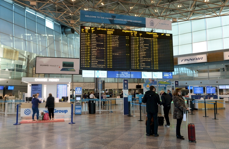 Passenger check for delays and cancellations at Helsinki-Vantaa Airport on Monday (Image: Lehtikuva)