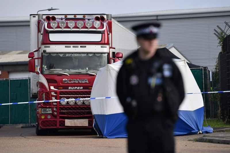 British police guard a lorry in Essex where the bodies of 39 people were found earlier today (Image: Lehtikuva)