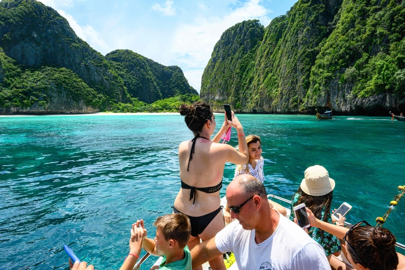 Tourists snap photos at Maya Bay in Thailand, which is about to be closed to the public (Image: Lehtikuva)
