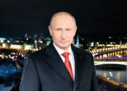 Putin thanks citizens for resolve, hints at harder times